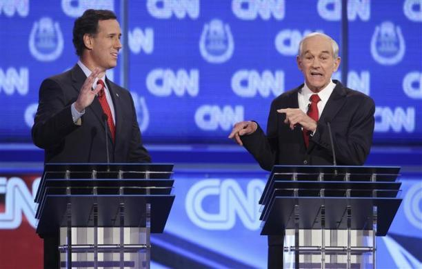 Rick Santorum and Ron Paul take part in the CNN Western Republican debate in Las Vegas, October 18, 2011. (REUTERS/Steve Marcus)