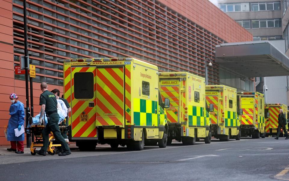 Medics transport a patient from an ambulance to the Royal London Hospital as the spread of the coronavirus disease (COVID-19) continues - HANNAH MCKAY/Reuters