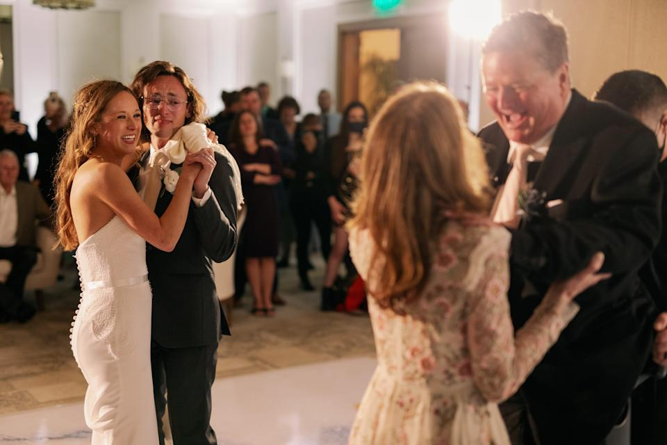 Savannah Boehrer (left) watches as her dad Sam Schmidt dances with her mom Sheila for the first time in 21 years.