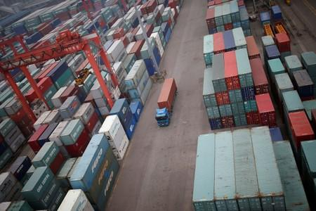 FILE PHOTO: A truck drives between shipping containers at a container terminal at Incheon port in Incheon