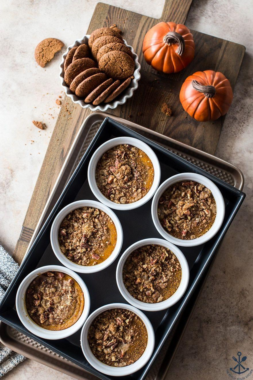 """<p>Get your fill of warm winter spices with a rich, creamy pumpkin custard topped with an irresistible cookie crumble. </p><p><a href=""""https://thebeachhousekitchen.com/2020/09/24/pumpkin-custards-with-gingersnap-crumble/"""" rel=""""nofollow noopener"""" target=""""_blank"""" data-ylk=""""slk:Get the recipe"""" class=""""link rapid-noclick-resp"""">Get the recipe</a>.</p>"""