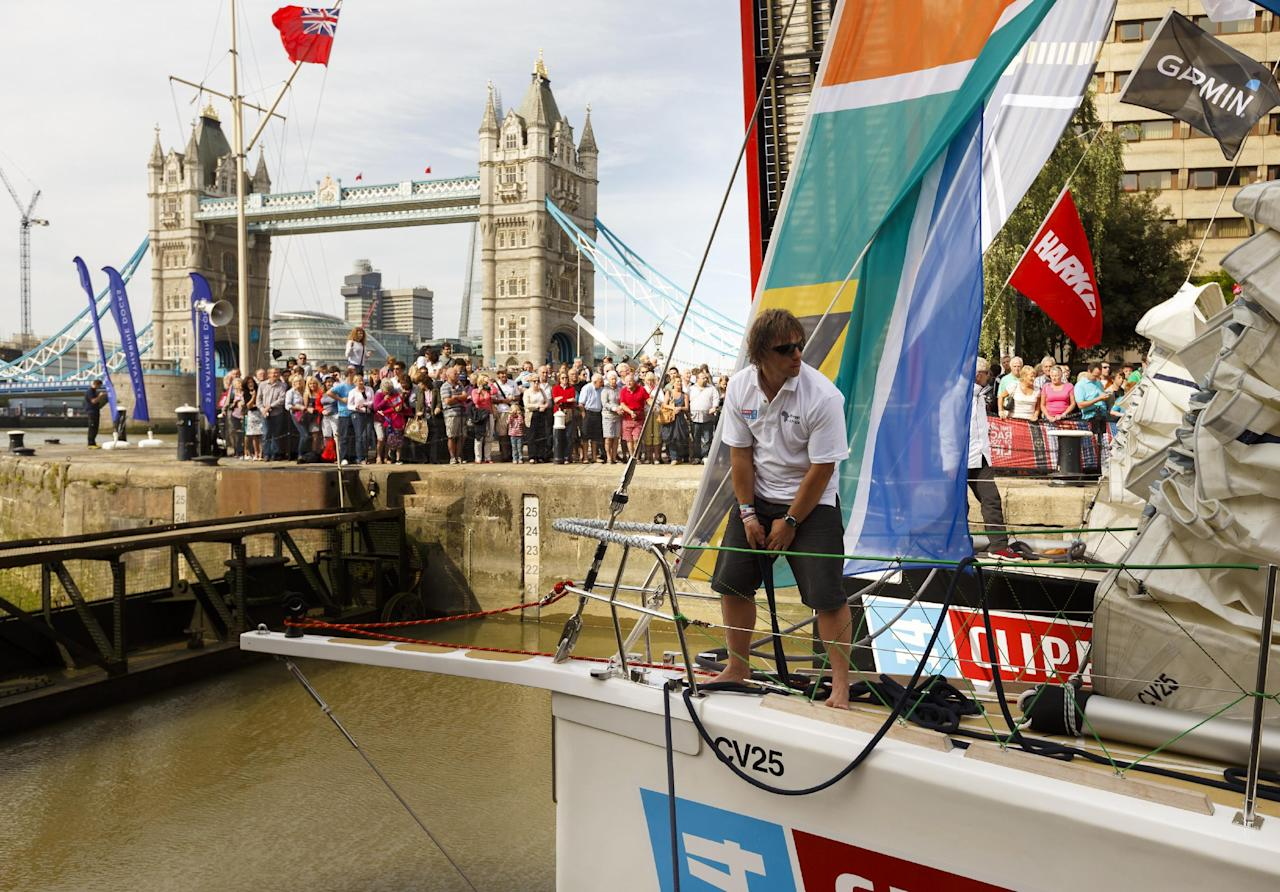 The Invest Africa yacht heads out through the lock at St Katharine's Dock during the start of the Clipper Round the World Race at St Katharine Docks, London.
