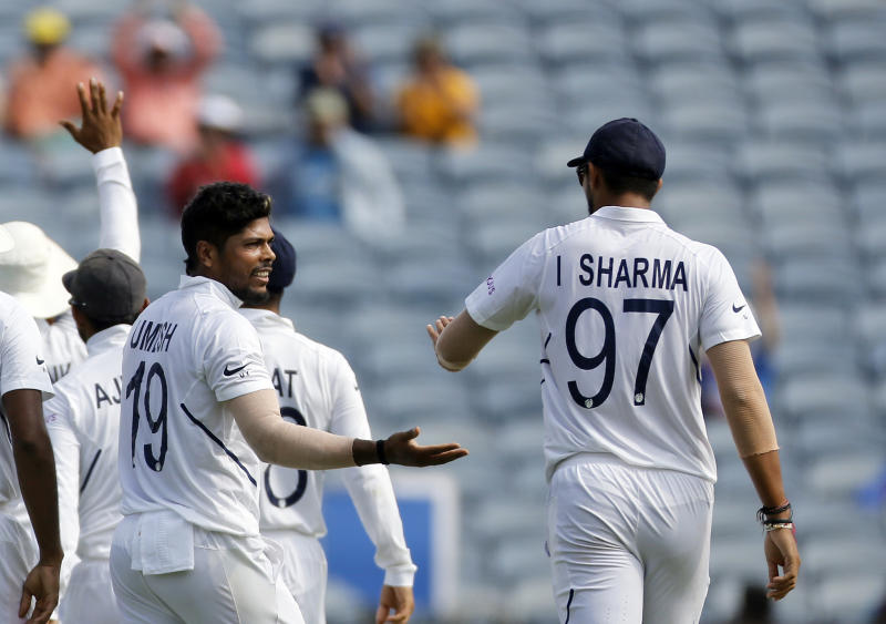 India's cricketer Umesh Yadav celebrates the dismissal of South Africa's Theunis de Bruyn during the third day of the second cricket test match between India and South Africa in Pune, India, Saturday, Oct. 12, 2019. (AP Photo/Rajanish Kakade)