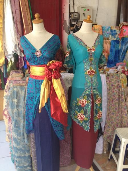 """Beauty on display: Traditional """"kebaya"""" dresses in silk and cotton with embroideries on display at one of the shops in Jl. Sulawesi, Denpasar. ("""
