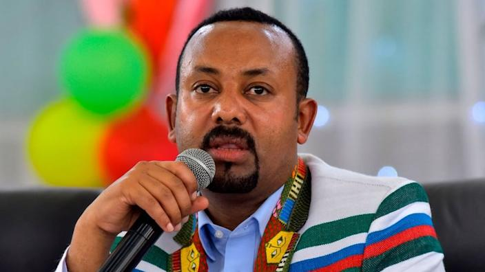 Ethiopian Prime Minister Abiy Ahmed, wearing a white coat bearing the traditional Kafficho colours of red, green and blue, address the crowd in Bonga, the main town in Kaffa province, some 449km south west of the capital Addis Ababa, on September 15, 2019