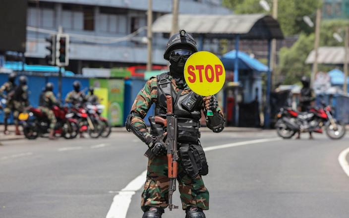 Sri Lankan Army soldiers stop vehicles at a checkpoint after the government announced an island-wide travel restrictions as a preventive measure against the spread of Covid-19 - CHAMILA KARUNARATHNE/EPA-EFE/Shutterstock
