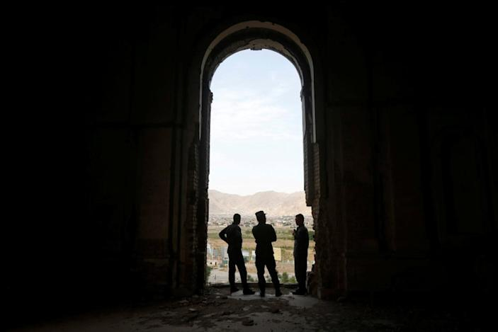 <p>Afghan policemen stand amid the ruins of Darul Aman Palace in Kabul, Afghanistan, June, 5, 2016. (Omar Sobhani/Reuters) </p>