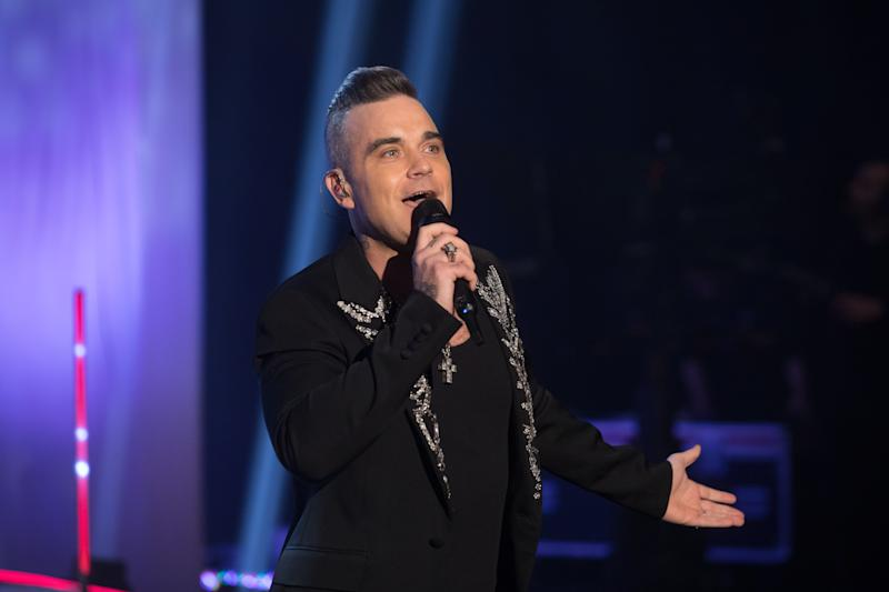 Robbie Williams performs during the filming for the Graham Norton Show at BBC Studioworks 6 Television Centre, Wood Lane, London, to be aired on BBC One on Friday evening. Picture date: Thursday December 19, 2019. Photo credit should read: PA Images on behalf of So TV (Photo by David Parry/PA Images via Getty Images)