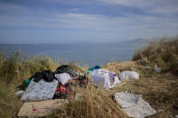 Mattress and belongings of migrants sit atop of a hill in the Spanish enclave of Ceuta, near the border of Morocco and Spain, Friday, May 21, 2021. Spain says it has returned to Morocco over 6,600 of the more than 8,000 migrants who swam or jumped over border fences into one of Spain's enclaves in North Africa this week. (AP Photo/Bernat Armangue)