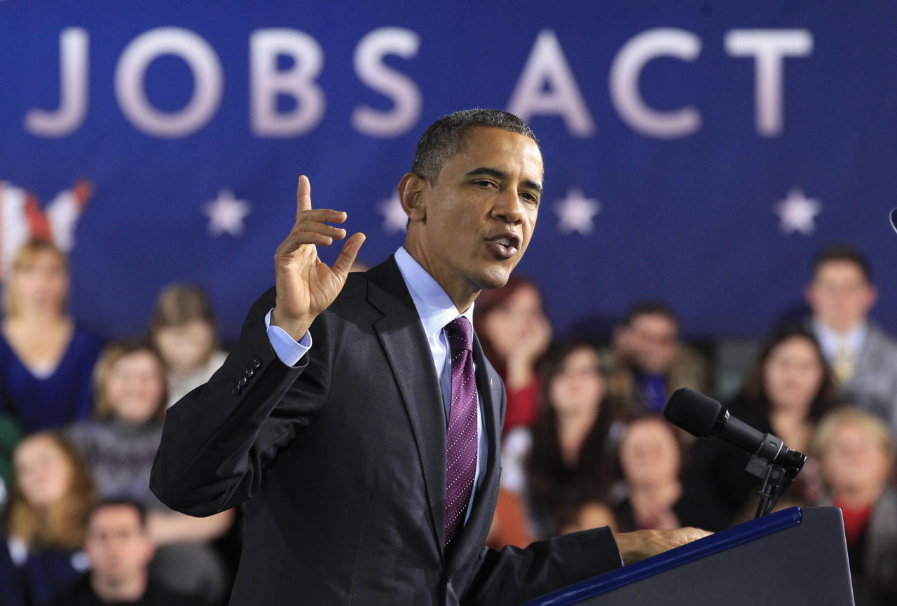 U.S. President Barack Obama delivers remarks on the American Jobs Act at Manchester High School Central in Manchester, New Hampshire November 22, 2011.  REUTERS/Kevin Lamarque  (UNITED STATES - Tags: BUSINESS EMPLOYMENT POLITICS TPX IMAGES OF THE DAY)