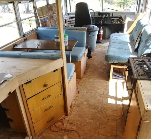 Verra used the couch and dinette from an old RV in the bus. She estimates she's spent a couple thousand dollars on wood, but most of the supplies have been donated.