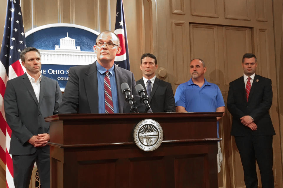 FILE-In a Tuesday, June 4, 2019 file photo, Roger Beedon discusses how sexual misconduct by now-deceased Ohio State team doctor Richard Strauss has affected his life, during a news conference with fellow Strauss accusers, from left, Brian Garrett, Dan Ritchie and Mike Flusche, and state Rep. Brett Hillyer, at the Statehouse in Columbus, Ohio. Beedon is among the men planning to appeal the dismissal of lawsuits they filed against Ohio State University over sexual abuse by the late team doctor Richard Strauss. Beedon says critics who question the plaintiffs' motives or think they're just after money don't understand what the survivors have been through and how it impacted their lives. (AP Photo/Kantele Franko, File)
