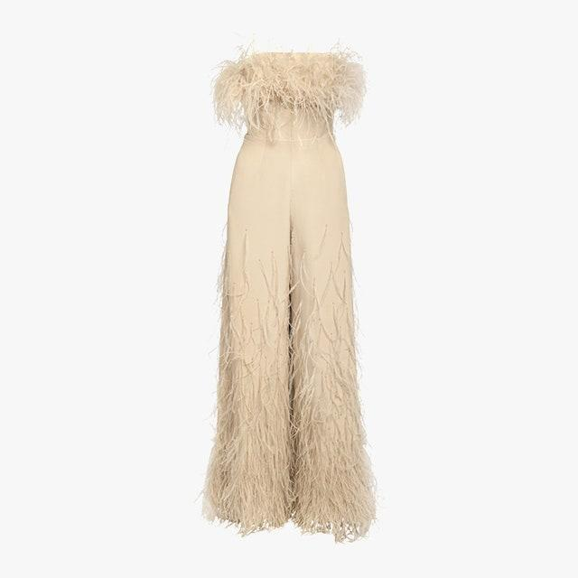 "$9855, MODA OPERANDI. <a href=""https://www.modaoperandi.com/women/p/khyeli/silk-feather-jumpsuit/450049"" rel=""nofollow noopener"" target=""_blank"" data-ylk=""slk:Get it now!"" class=""link rapid-noclick-resp"">Get it now!</a>"