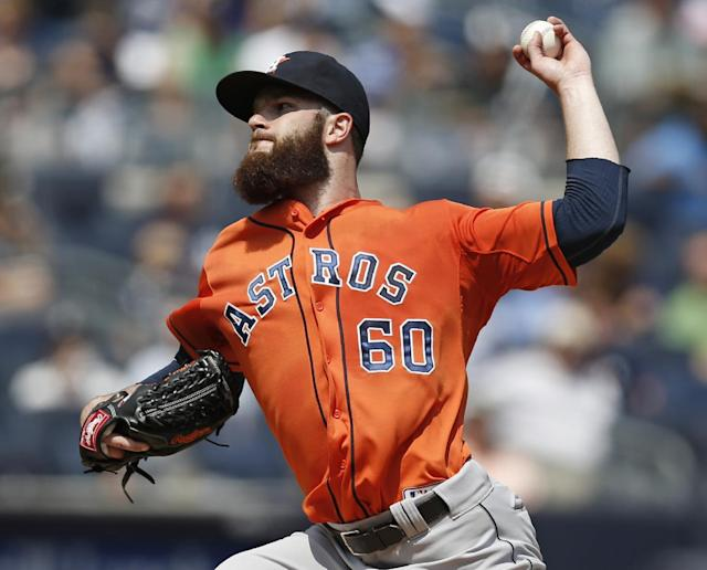 Houston Astros starting pitcher Dallas Keuchel delivers in the first inning of a baseball game against the New York Yankees at Yankee Stadium in New York, Thursday, Aug. 21, 2014. (AP Photo/Kathy Willens)