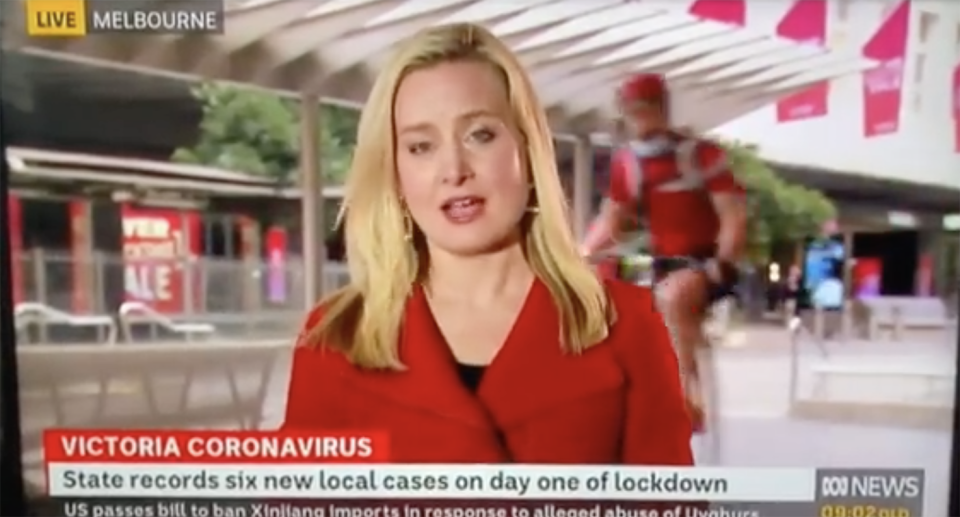 Internet loses it after spotting a penny-farthing cycle past in an ABC live cross. Source: Twitter/ABC