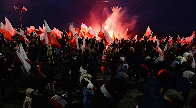 <p>Demonstrators burn flares and wave Polish flags during the annual march to commemorate Poland's National Independence Day in Warsaw, Poland, Saturday, Nov. 11, 2017. (Photo: Czarek Sokolowski/AP) </p>