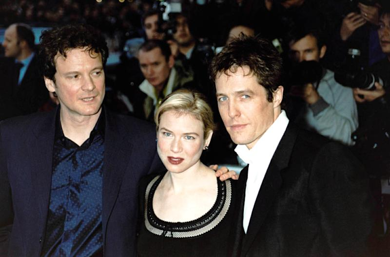 Zellweger arrives at the UK premiere of Bridget Jones's Diary in London with co-stars Colin Firth (left) and Hugh Grant. (Photo: William Conran – PA Images/PA Images via Getty Images)