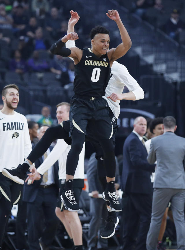 Colorado's Shane Gatling (0) celebrates after a play against Washington during the first half of an NCAA college basketball game in the semifinals of the Pac-12 men's tournament Friday, March 15, 2019, in Las Vegas. (AP Photo/John Locher)