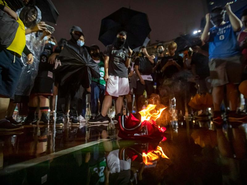 Demonstrators in Hong Kong burn a LeBron James basketball jersey in protest at his comments over free speech: AP