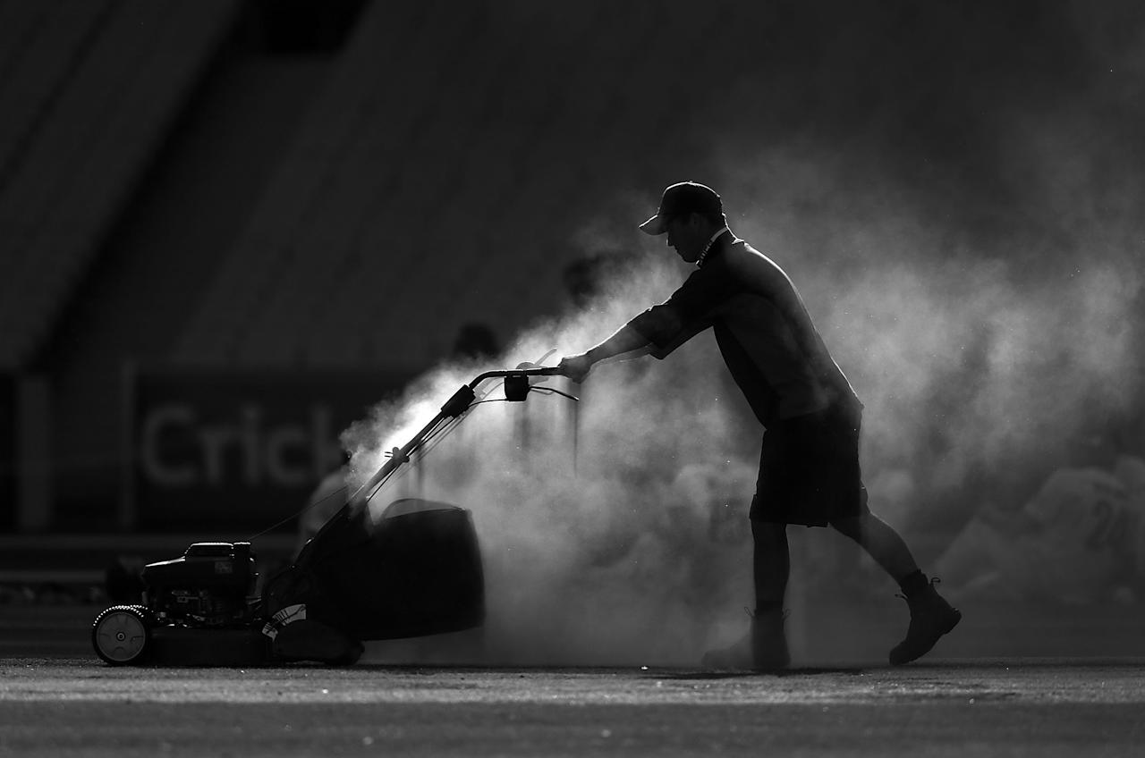 MELBOURNE, AUSTRALIA - FEBRUARY 18: (EDITORS NOTE: Image has been converted to black and white.)A groundsman mows the wicket after day one of the Sheffield Shield match between the Victorian Bushrangers and the Queensland Bulls at Melbourne Cricket Ground on February 18, 2013 in Melbourne, Australia.  (Photo by Michael Dodge/Getty Images)