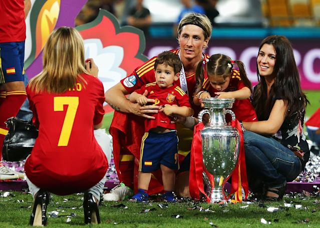 KIEV, UKRAINE - JULY 01: Fernando Torres of Spain poses for a photograph with his wife Olalla Dominguez and their children Leo Torres and Nora Torres on the pitch following victory in the UEFA EURO 2012 final match between Spain and Italy at the Olympic Stadium on July 1, 2012 in Kiev, Ukraine. (Photo by Alex Grimm/Getty Images)