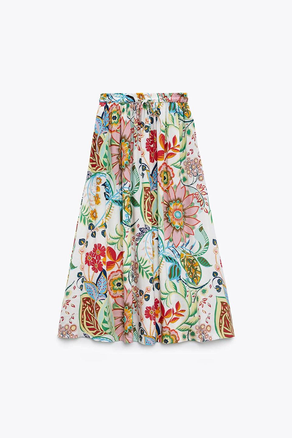 """<h2>Zara Floral Printed Skirt</h2><br>Another wanderlust-centered comeback that took purchase place in May: the long skirt. As part of Emily Ruane's guide to <a href=""""https://refinery29.com/en-us/travel-outfits"""" rel=""""nofollow noopener"""" target=""""_blank"""" data-ylk=""""slk:travel outfits"""" class=""""link rapid-noclick-resp"""">travel outfits</a> that will make you the main character at the airport, Zara's floral skirt became the choice buy for <em>The Gamine</em> archetype. From a more tangible (aka practical) standpoint, printed skirts are an easy way to dress up your jet-set attire without sacrificing comfort; they offer leg coverage minus the constriction of pants, they're public-bathroom-approved for pulling up to avoid fabric touching the gross ground, AND they can be seamlessly worn from plane to out on the town.<br><br><em>Shop <strong><a href=""""https://www.zara.com/us/en/floral-printed-skirt-p03090199.html"""" rel=""""nofollow noopener"""" target=""""_blank"""" data-ylk=""""slk:Zara"""" class=""""link rapid-noclick-resp"""">Zara</a></strong></em><br><br><strong>Zara</strong> Floral Printed Skirt, $, available at <a href=""""https://go.skimresources.com/?id=30283X879131&url=https%3A%2F%2Fwww.zara.com%2Fus%2Fen%2Ffloral-printed-skirt-p03090199.html%3Fv1%3D103366838%26v2%3D1718788"""" rel=""""nofollow noopener"""" target=""""_blank"""" data-ylk=""""slk:Zara"""" class=""""link rapid-noclick-resp"""">Zara</a>"""