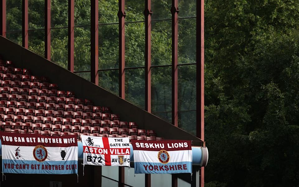 Aston Villa flags are seen hanging inside the stadium prior to the Premier League match between Aston Villa and Sheffield United - GETTY IMAGES