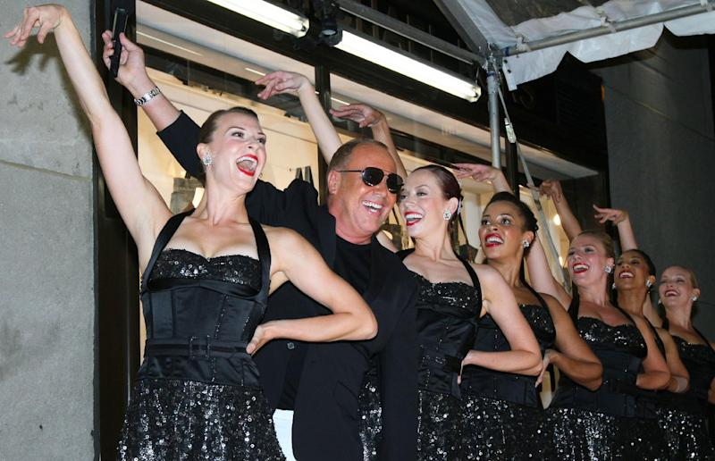Designer Michael Kors, second from left, poses with The Rockettes after their performance outside the new Michael Kors Rockefeller Center Lifestyle flagship store as they celebrate Fashion's Night Out Thursday Sept. 8, 2011 in New York.   (AP Photo/Tina Fineberg)