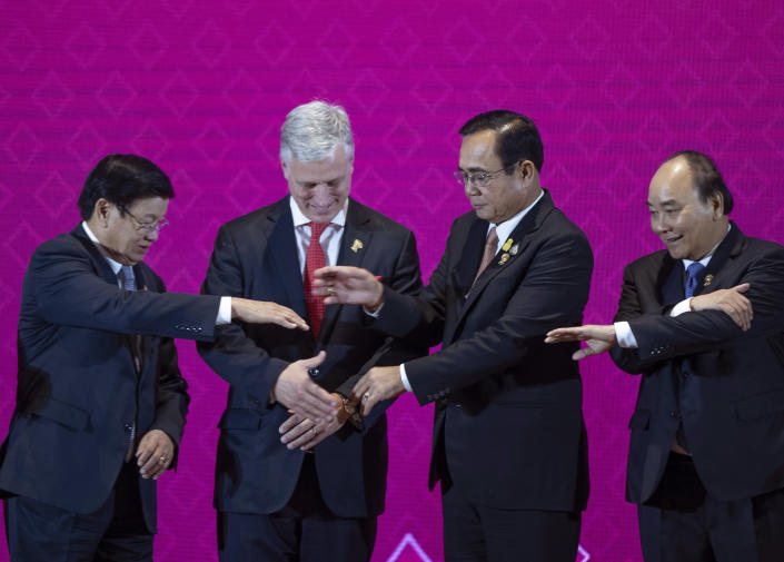 In this Monday, Nov. 4, 2019, file photo, U.S. National Security Adviser Robert O'Brien, second left, with ASEAN leaders, from left, Laos Prime Minister Thongloun Sisoulith, Thailand Prime Minister Prayuth Chan-ocha, and Vietnamese Prime Minister Nguyen Xuan Phuc prepares to shake hands in traditional ASEAN-way during ASEAN-US summit in Nonthaburi, Thailand. (AP Photo/Gemunu Amarasinghe, File)