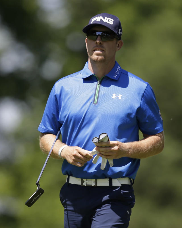 Hunter Mahan walks to the ninth green during the second round of the Memorial golf tournament Friday, May 30, 2014, in Dublin, Ohio. (AP Photo/Darron Cummings)