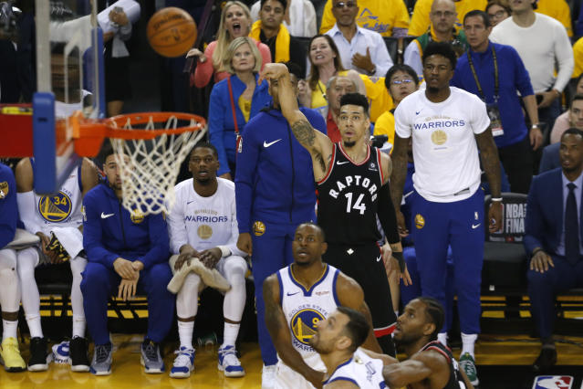 Danny Green #14 of the Toronto Raptors attempts a shot against the Golden State Warriors in the first half during Game Three of the 2019 NBA Finals at ORACLE Arena on June 05, 2019 in Oakland, California. (Photo by Lachlan Cunningham/Getty Images)