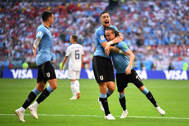 Soccer Football - World Cup - Group A - Uruguay vs Russia - Samara Arena, Samara, Russia - June 25, 2018 Uruguay's Diego Laxalt celebrates scoring their second goal with Sebastian Coates REUTERS/Dylan Martinez