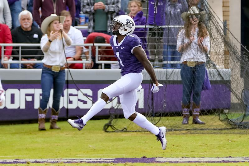 FORT WORTH, TX - OCTOBER 20: TCU Horned Frogs wide receiver Jalen Reagor (1) celebrates a 33 yard touchdown reception during the game between the Oklahoma Sooners and TCU Horned Frogs on October 20, 2018 at Amon G. Carter Stadium in Fort Worth, TX. (Photo by Andrew Dieb/Icon Sportswire via Getty Images)