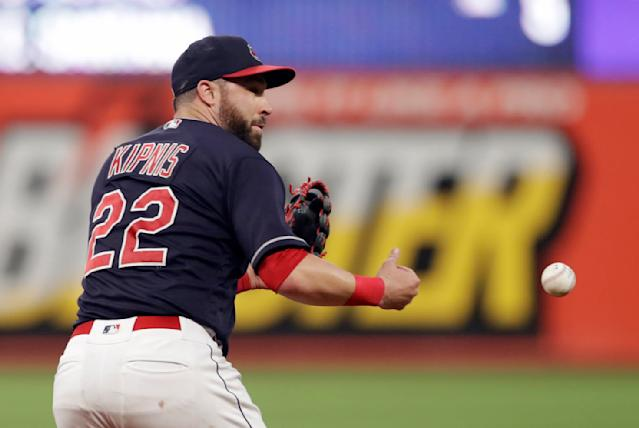 Cleveland Indians' Jason Kipnis bobbles the ball in the seventh inning of a baseball game against the Cincinnati Reds, Monday, July 9, 2018, in Cleveland. Jose Peraza grounded into a fielders choice and was safe at first base. Scott Schebler was safe at second base on Kipnis' error. (AP Photo/Tony Dejak)