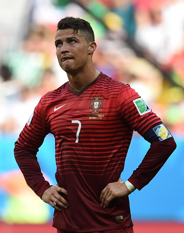 Portugal's Cristiano Ronaldo stands with hands on hips during the group G World Cup soccer match between Portugal and Ghana at the Estadio Nacional in Brasilia, Brazil, Thursday, June 26, 2014. Portugal won 2-1 but were eliminated from the competition. (AP Photo/Paulo Duarte)