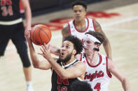 Nebraska's Kobe Webster, left, past Rutgers' Paul Mulcahy, front right, in the first half of an NCAA college basketball game Monday, March 1, 2021, in Lincoln, Neb. (Kenneth Ferriera/Lincoln Journal Star via AP)