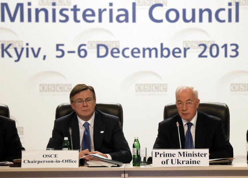 Ukraine's Prime Minister Mykola Azarov, right, along with Foreign Minister Leonid Kozhara, addresses the Organization for Security and Cooperation in Europe's ministerial council summit in Kiev, Ukraine, Thursday, Dec. 5, 2013. (AP Photo/Efrem Lukatsky)