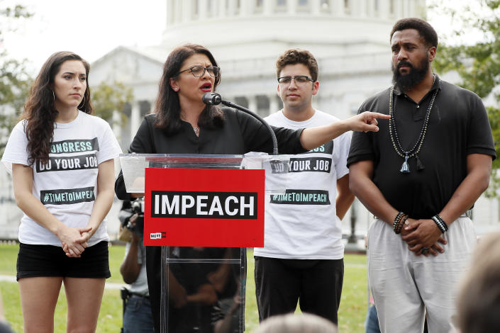 """Rep. Rashida Tlaib, D-Mich., center, at the """"Impeachment Now!"""" rally in Washington, D.C., on Sept. 26. (Photo: Paul Morigi/Getty Images for MoveOn Political Action)"""