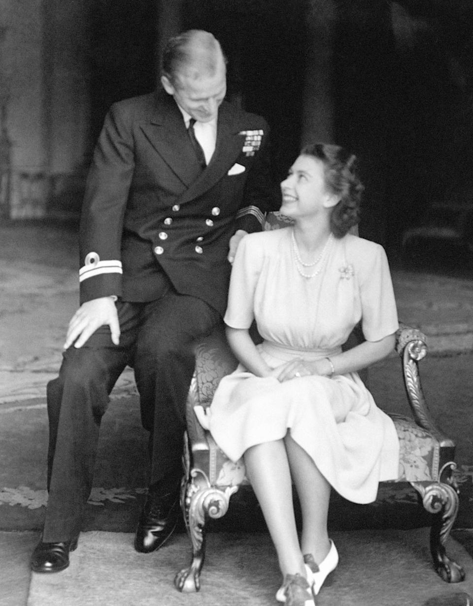 Announcing the royal engagement at Buckingham Palace in 1947PA