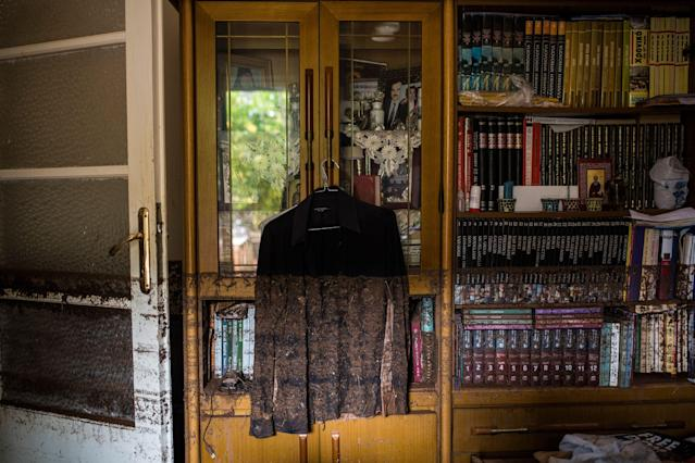<p>A photo shows a shirt hanging near a bookcase marked with mud from floodwater in a house in Mandra, northwest of Athens, on Nov. 16, 2017, after heavy rainfall caused flooding early on November 15. (Photo: Angelos Tzortzinis/AFP/Getty Images) </p>