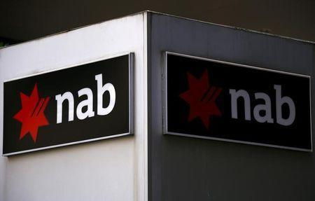 A National Australia Bank (NAB) sign is displayed outside an office building in central Sydney, Australia, July 24, 2015. REUTERS/David Gray