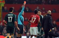 Referee Cuneyt Cakir shows Manchester United winger Nani the red card during the UEFA Champions League clash at Old Trafford on March 5, 2013. Real Madrid won 2-1 on the night, 3-2 on aggregate, to move into the quarter-finals