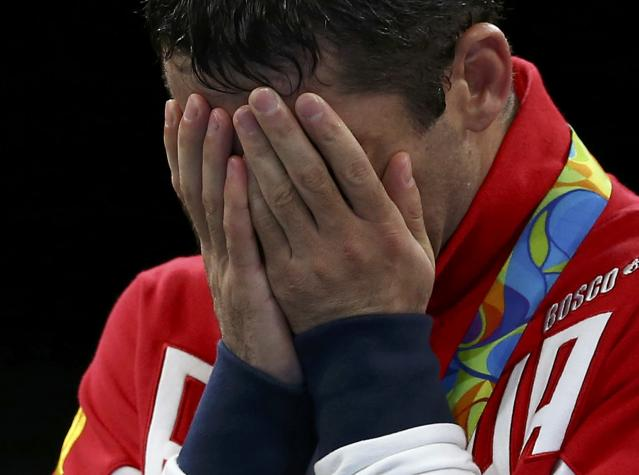 2016 Rio Olympics - Boxing - Victory Ceremony - Men's Fly (52kg) Victory Ceremony - Riocentro - Pavilion 6 - Rio de Janeiro, Brazil - 21/08/2016. Silver medallist Misha Aloian (RUS) of Russia reacts. REUTERS/Peter Cziborra FOR EDITORIAL USE ONLY. NOT FOR SALE FOR MARKETING OR ADVERTISING CAMPAIGNS.