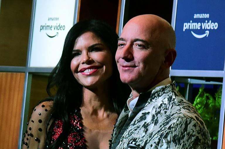 Jeff Bezos and his girlfriend Lauren Sanchez pose for pictures as they arrive to attend an event in Mumbai on January 16, 2020
