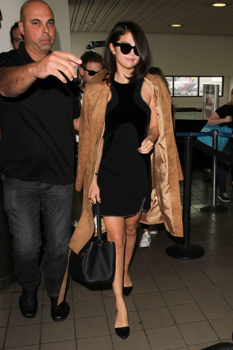<p>Arriving at LAX airport in Los Angeles wearing a $70 H&M coat over an Alexander Wang dress with Giuseppe Zanotti pumps.</p>