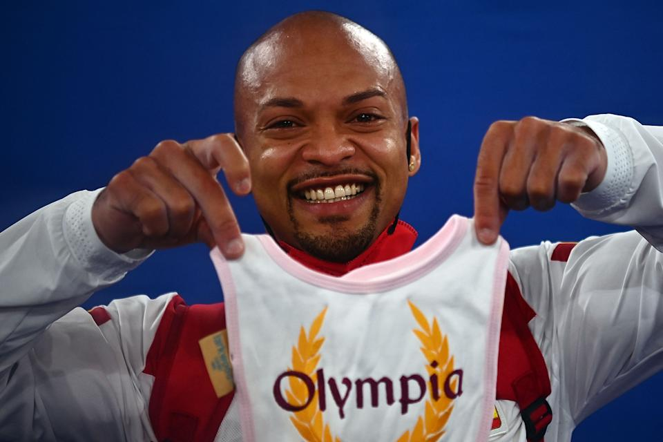 Rayderley Zapata (pictured) holds up a bib in celebration after competing in the floor event during the Tokyo 2020 Olympic Games.