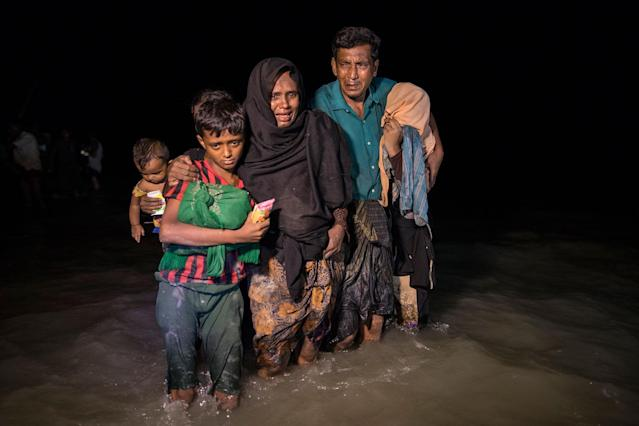 <p>Hundreds of Rohingya arrive by boats in the safety of darkness via the September 26, on Shah Porir Dwip island, Cox's Bazar, Bangladesh. (Photograph by Paula Bronstein/Getty Images) </p>
