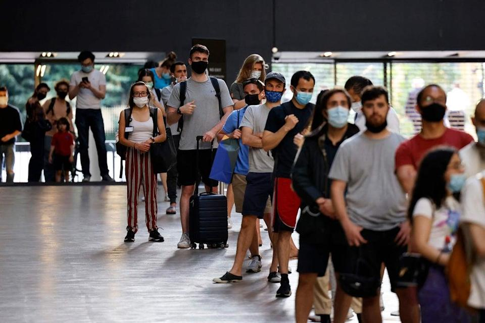Members of the public queuing to receive the Covid-19 vaccine at the Tate Modern in July  (AFP via Getty Images)