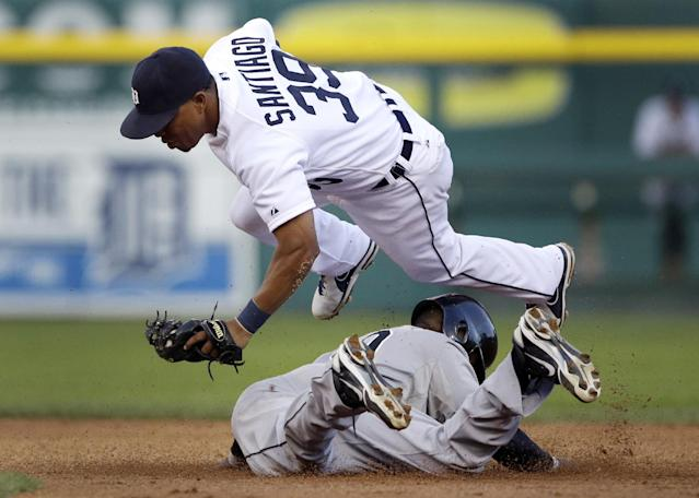 Detroit Tigers second baseman Ramon Santiago jumps over Chicago White Sox's Alejandro De Aza as De Aza steals second during the third inning of a baseball game in Detroit, Saturday, Aug. 3, 2013. (AP Photo/Carlos Osorio)