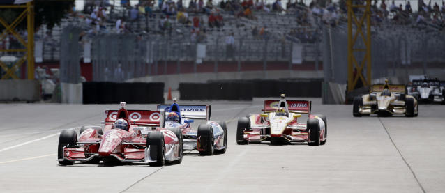 Scott Dixon, of New Zealand, leads the pack out of the pits during practice for the IndyCar Grand Prix of Houston auto race, Friday, Oct. 4, 2013, in Houston. Practice was delayed due to surface issues in turn one. (AP Photo/David J. Phillip)